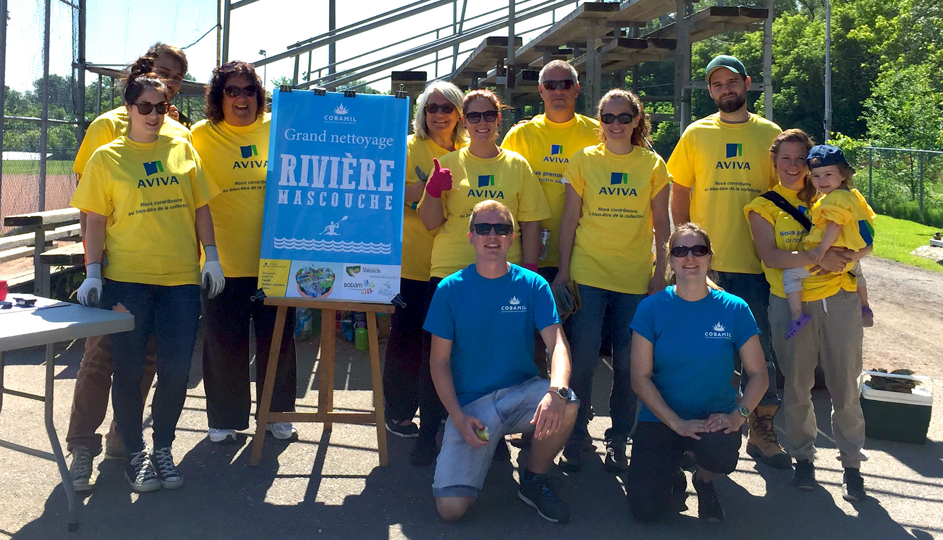 Charity representatives at the river cleanup in Quebec